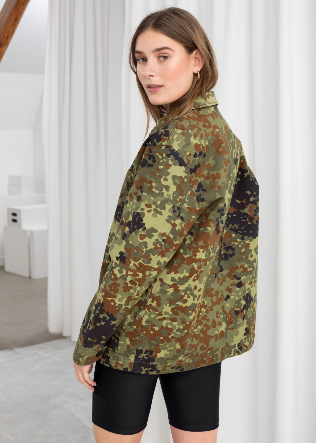Model back image of Stories camouflage cotton workwear jacket in green
