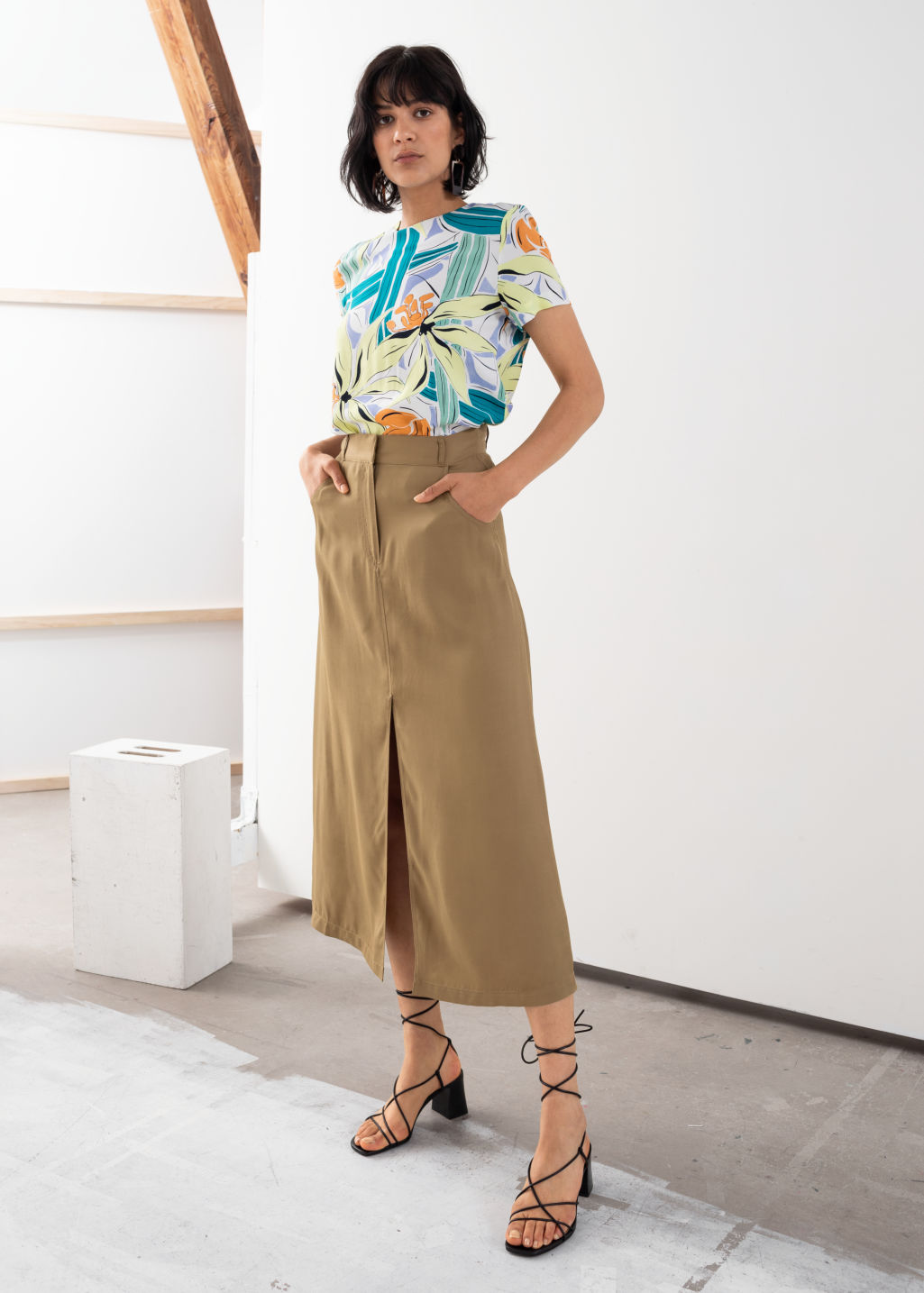 Model front image of Stories front slit a-line midi skirt in beige