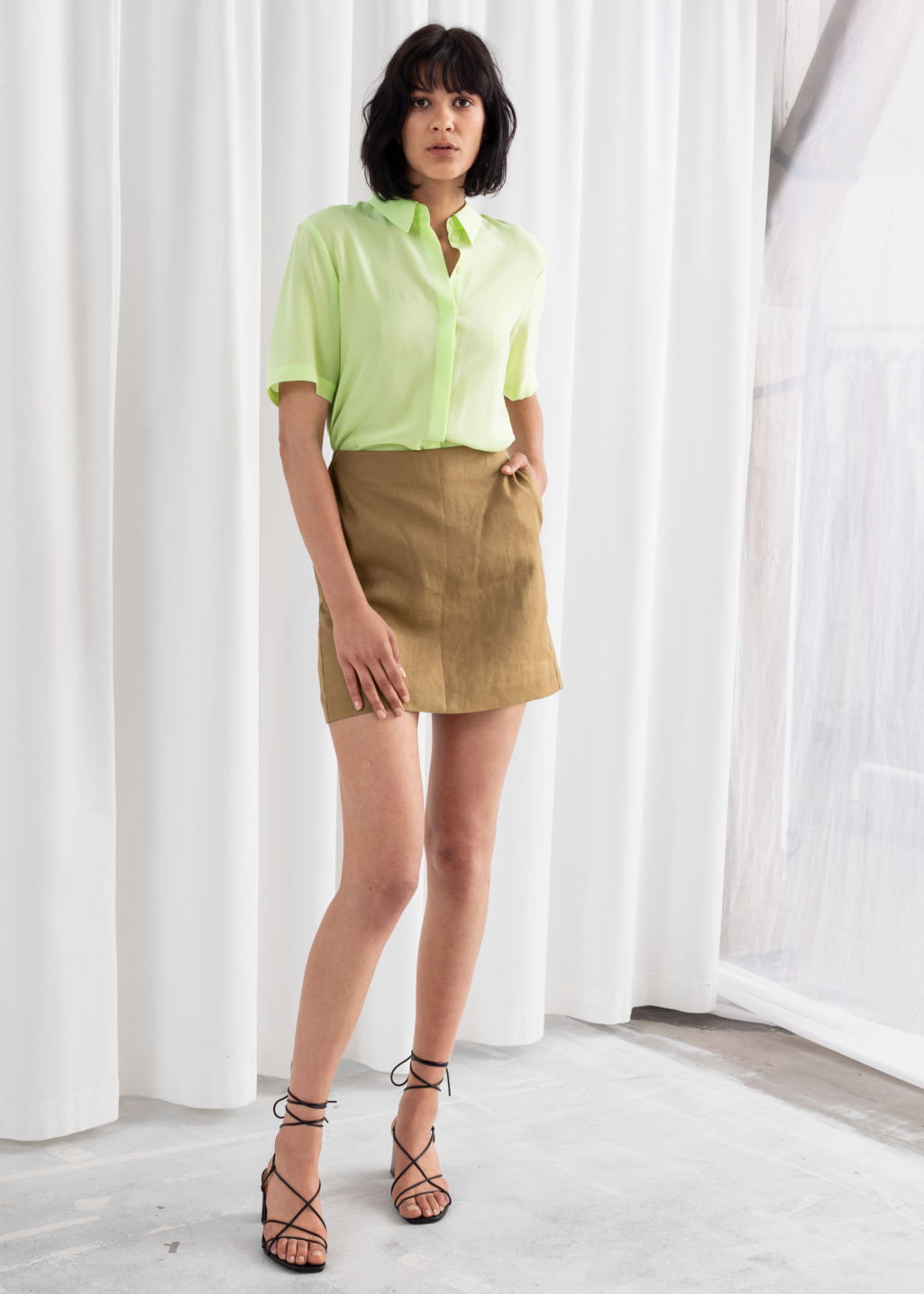 Model front image of Stories linen mini skirt in beige