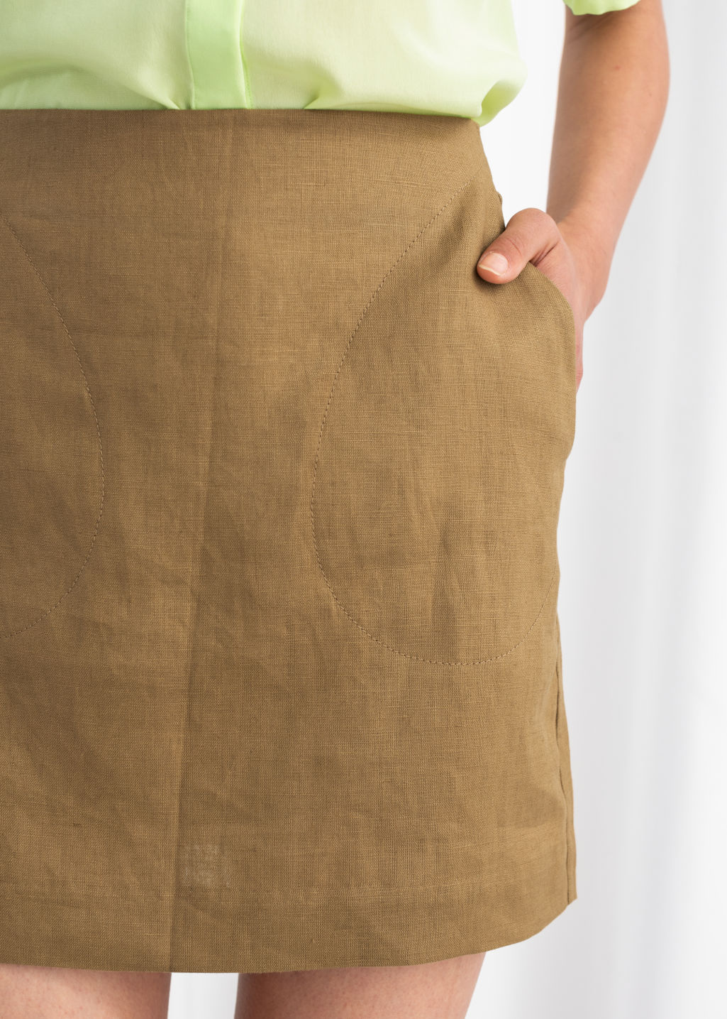 Model back image of Stories linen mini skirt in beige
