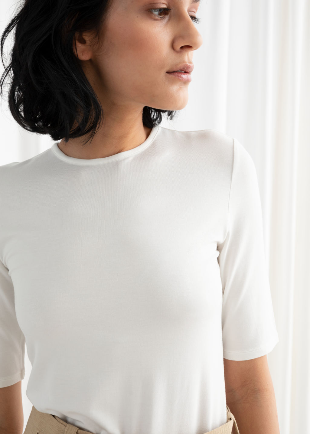 Model back image of Stories high neck fitted tee in white