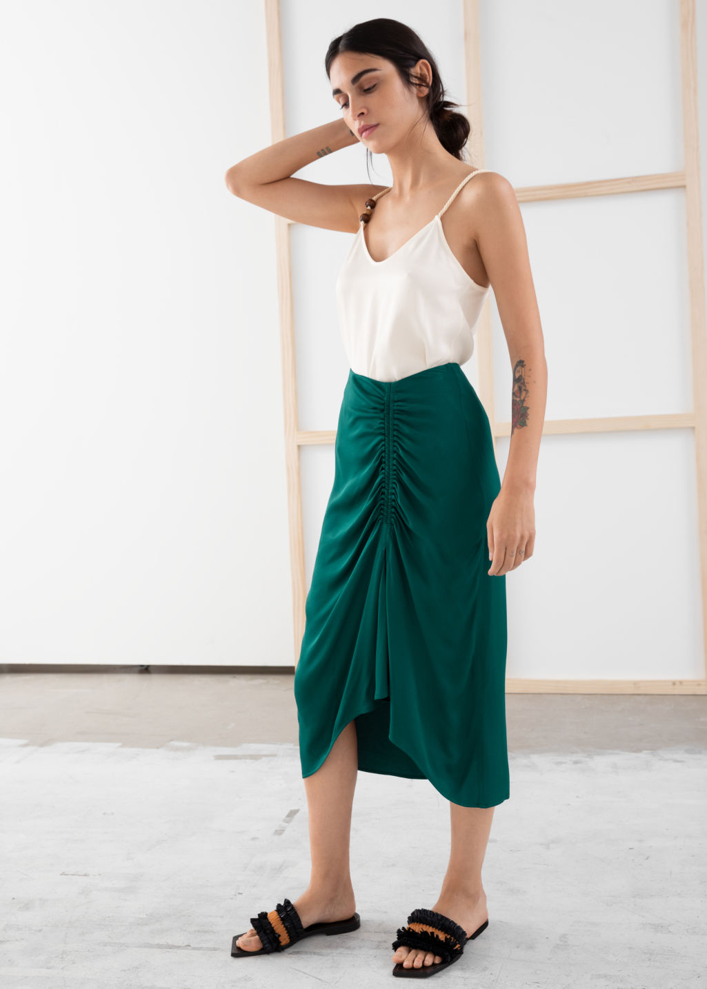Model front image of Stories gathered satin midi skirt in green