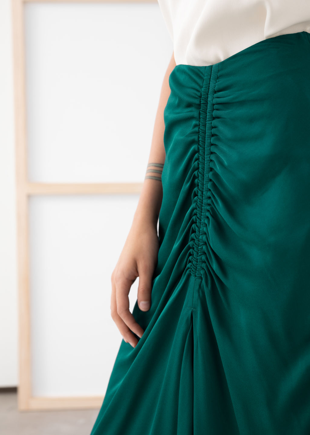 Model back image of Stories gathered satin midi skirt in green