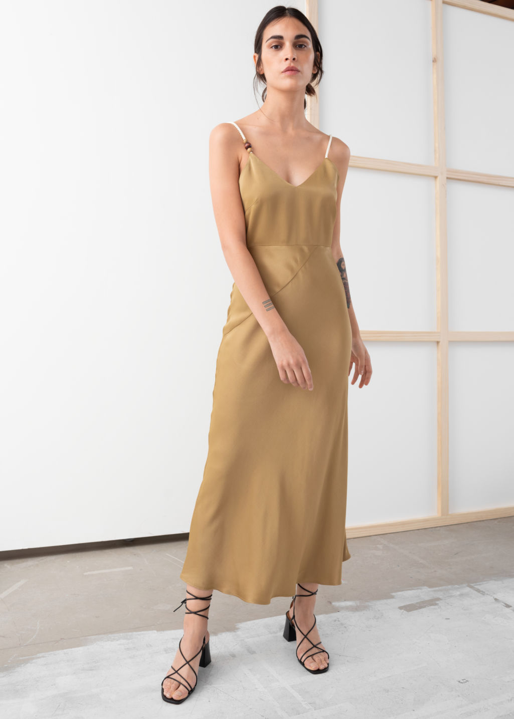 Model front image of Stories rope strap midi slip dress in beige