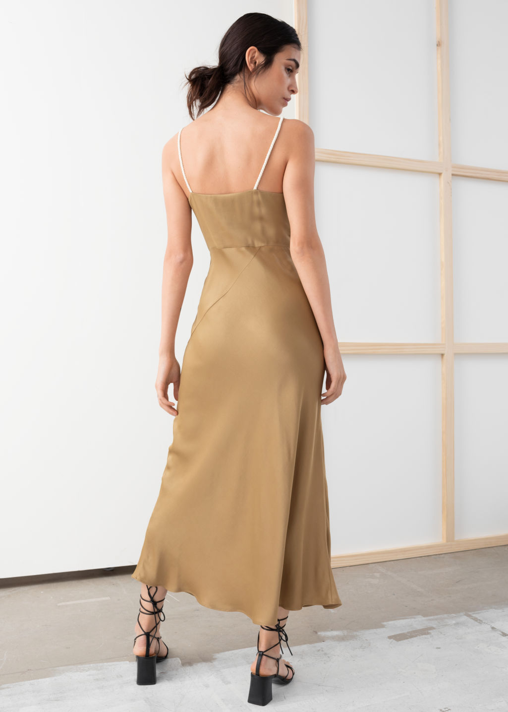 Model back image of Stories rope strap midi slip dress in beige