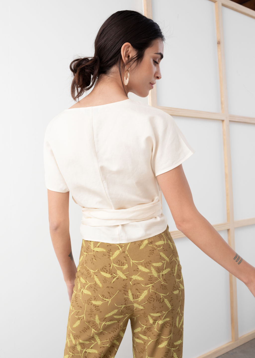 Model back image of Stories linen blend wrap top in white
