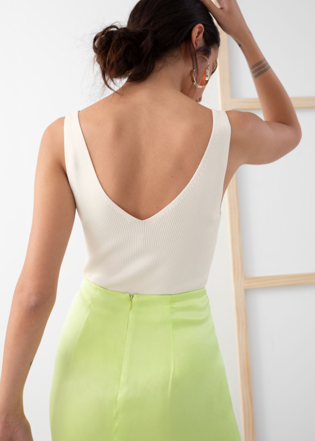 Model back image of Stories stretch rib knit tank top in white