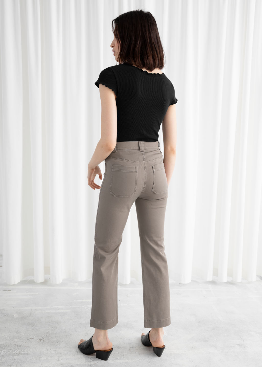 Model back image of Stories cotton twill blend trousers in brown