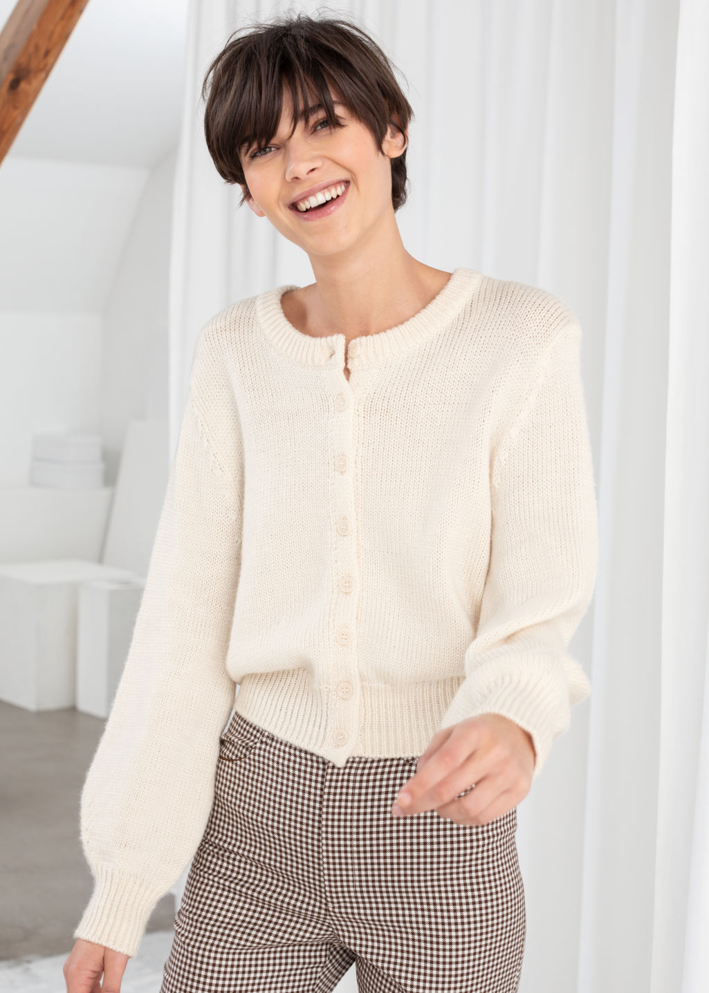 Model front image of Stories cropped wool blend cardigan in white