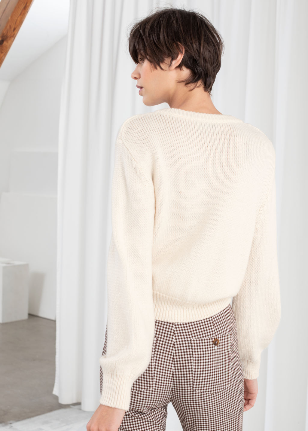 Model back image of Stories cropped wool blend cardigan in white