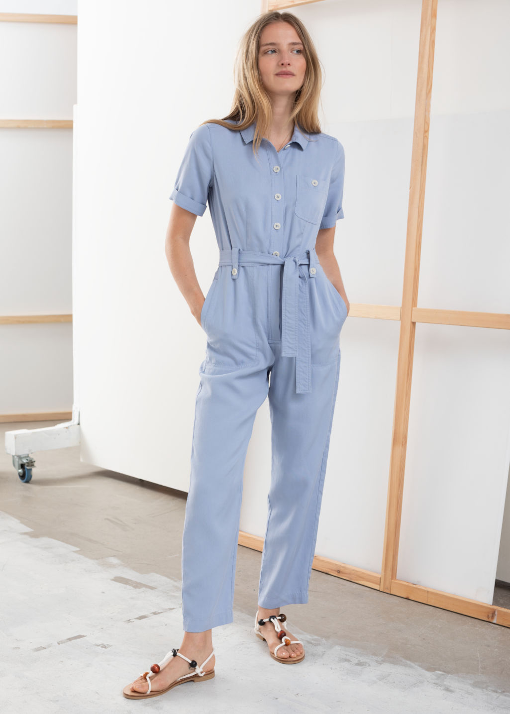Model front image of Stories belted lyocell jumpsuit in blue
