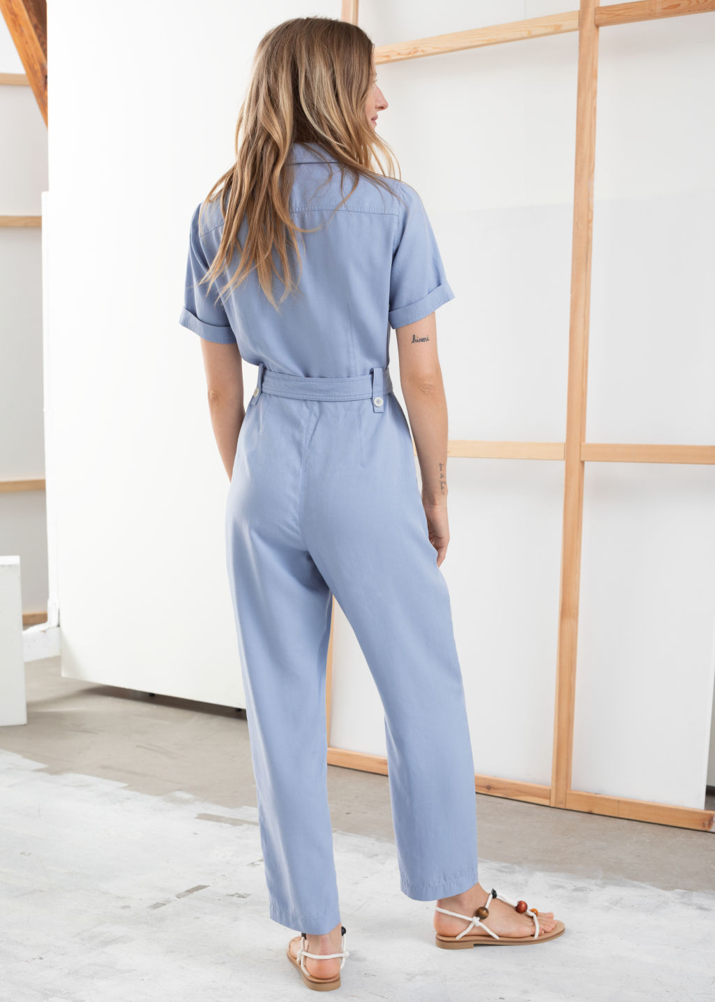 Model back image of Stories belted lyocell jumpsuit in blue