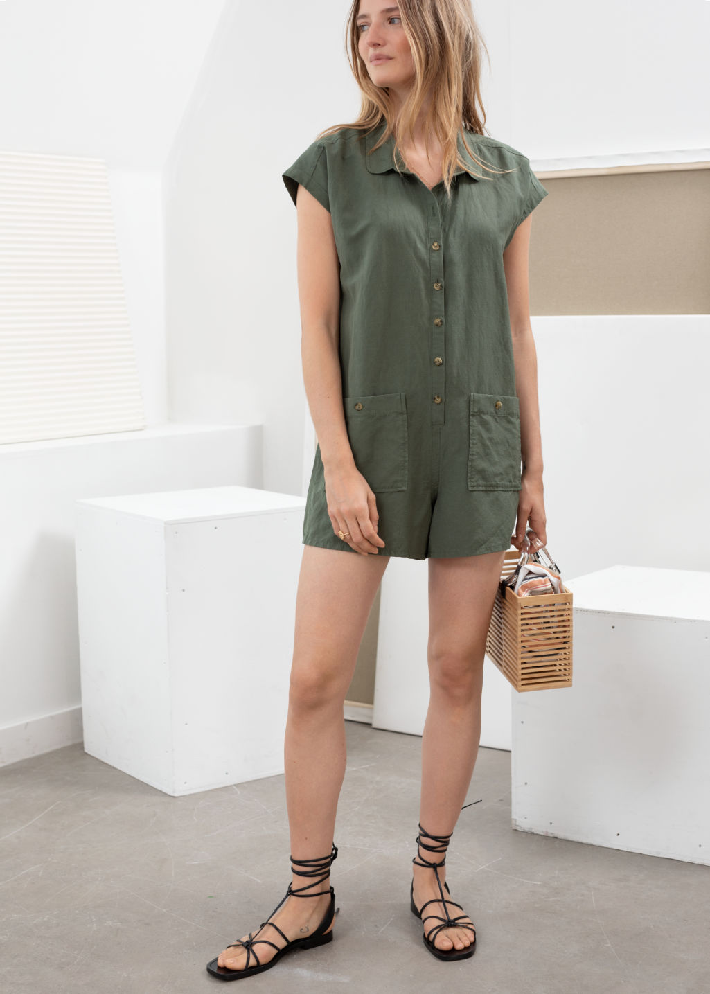 Model front image of Stories linen blend relaxed fit romper in green