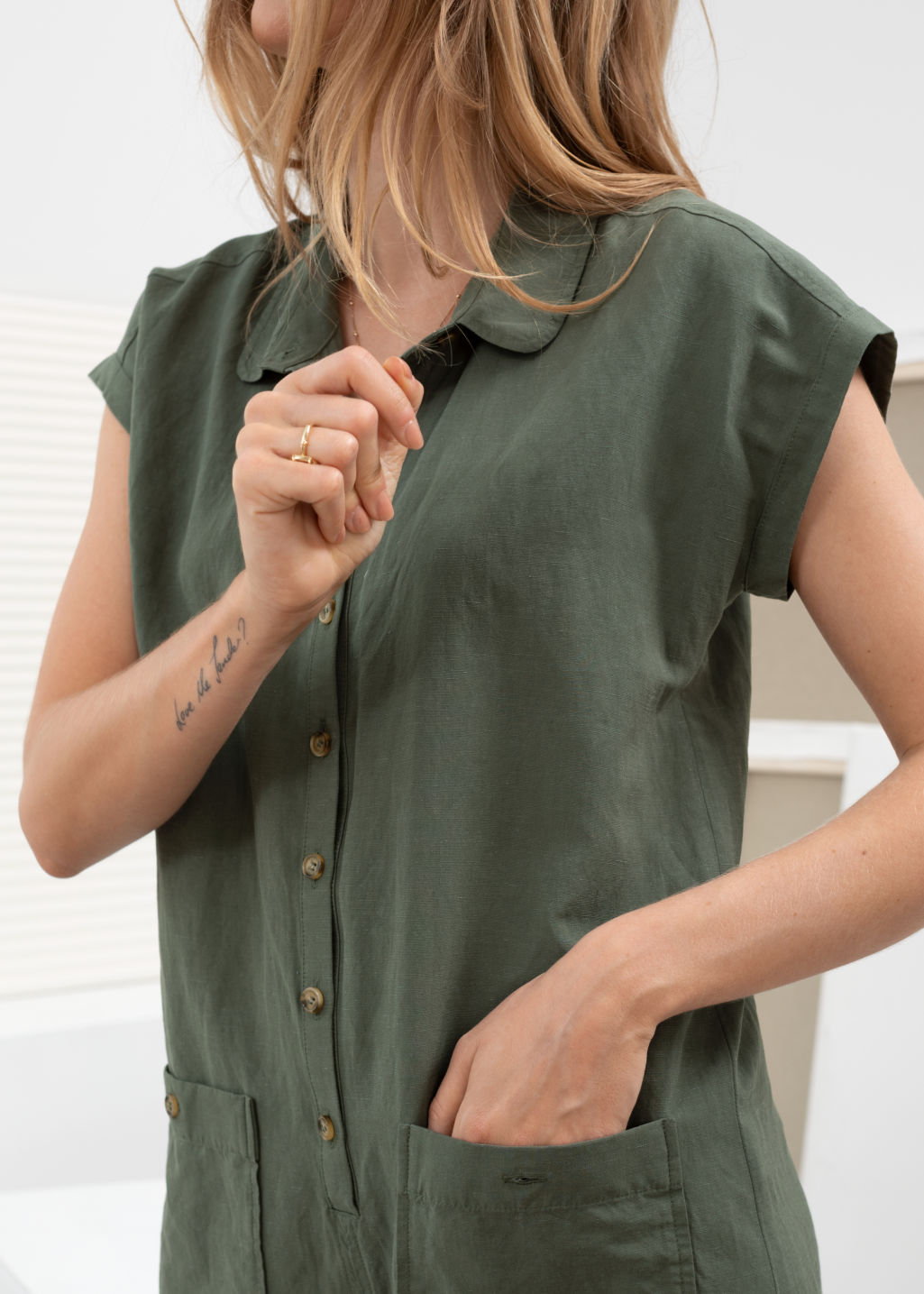 Model back image of Stories linen blend relaxed fit romper in green
