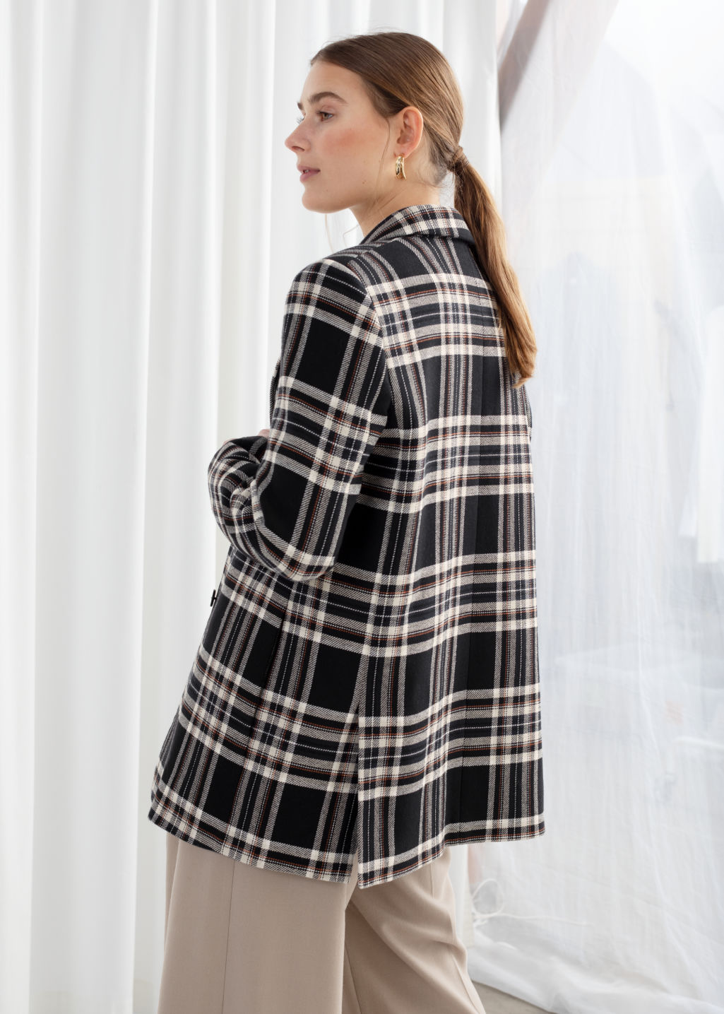 Model back image of Stories cotton blend plaid blazer in black