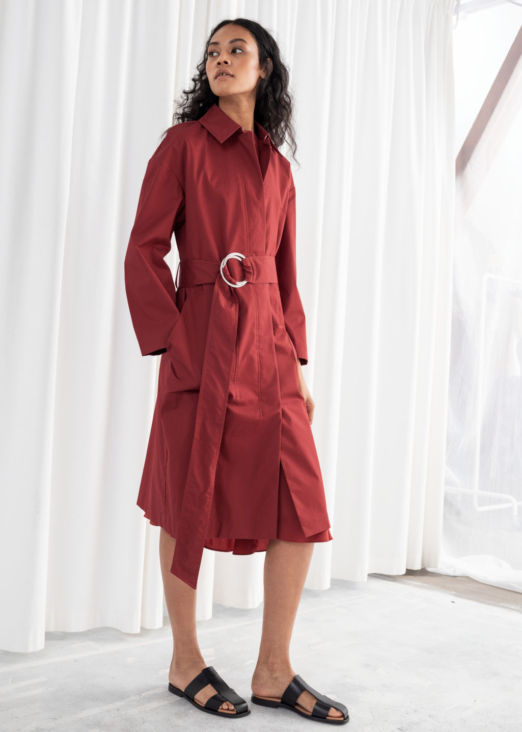 Model front image of Stories betled cotton twill trenchcoat in orange