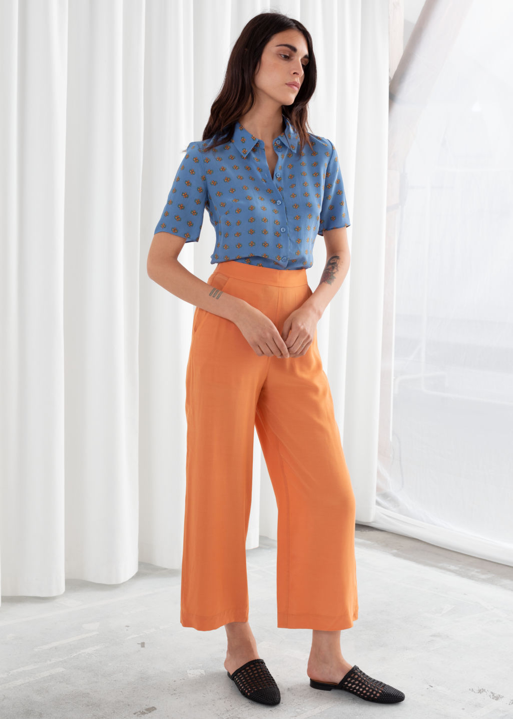 Model front image of Stories high waisted flared trousers in orange