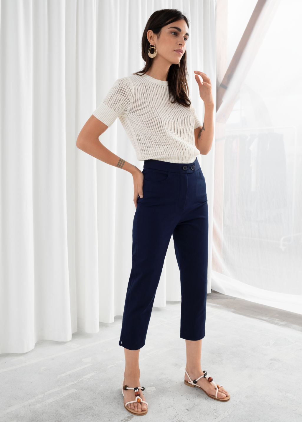 Model front image of Stories cropped tailored trousers in blue