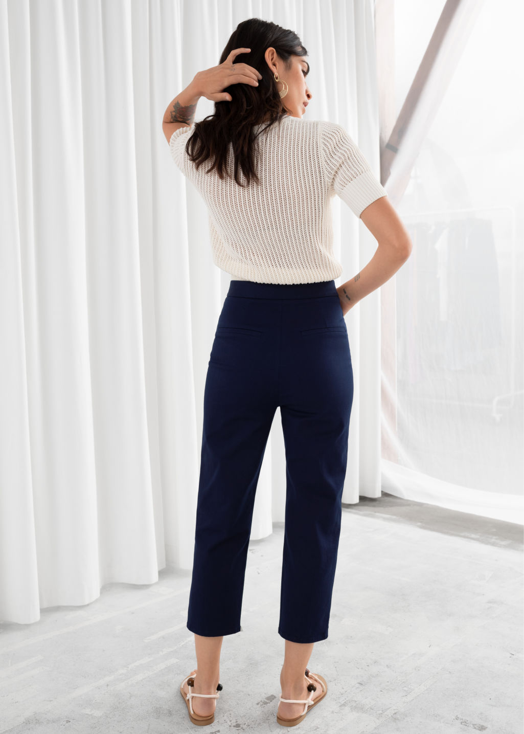 Model back image of Stories cropped tailored trousers in blue