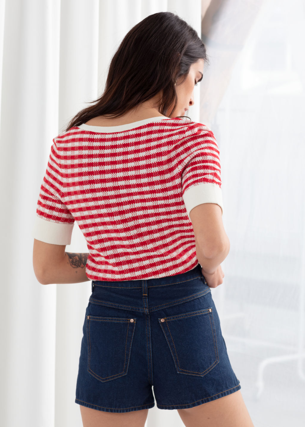 Model back image of Stories cotton silk micro knit top in red