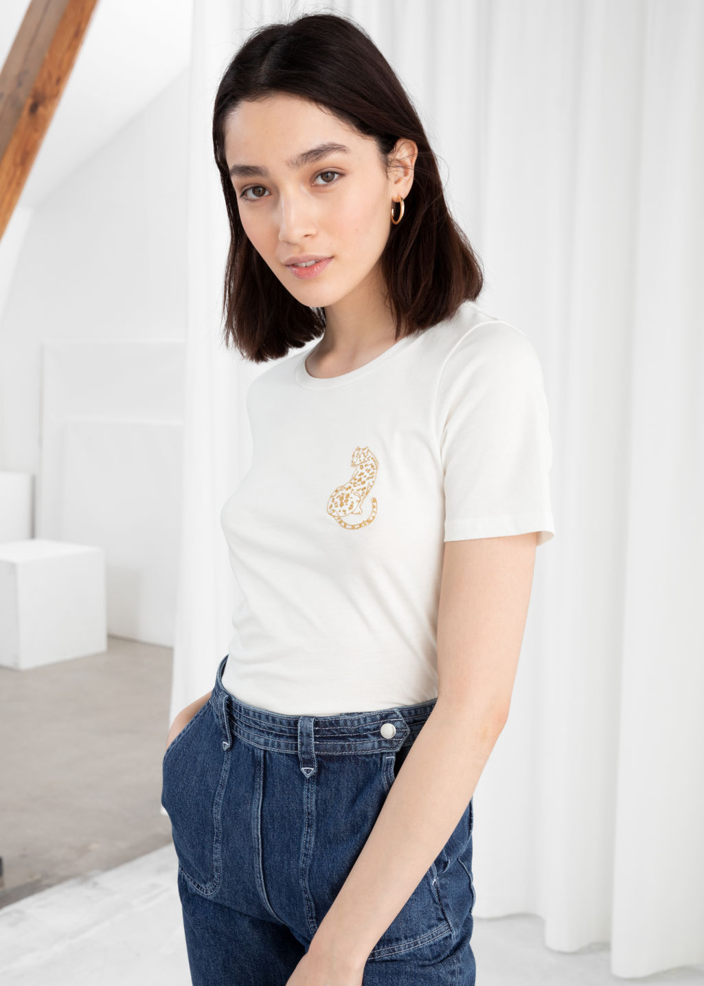 Model front image of Stories leopard embroidered cotton tee in white