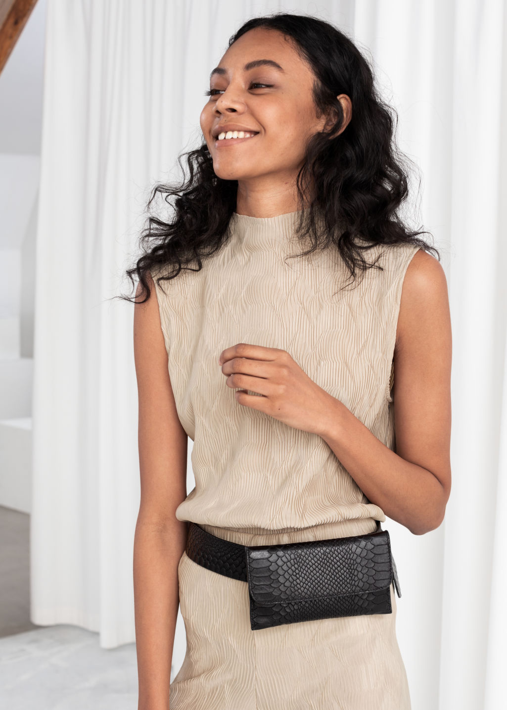 Model front image of Stories plissé pleated mock neck tank in beige