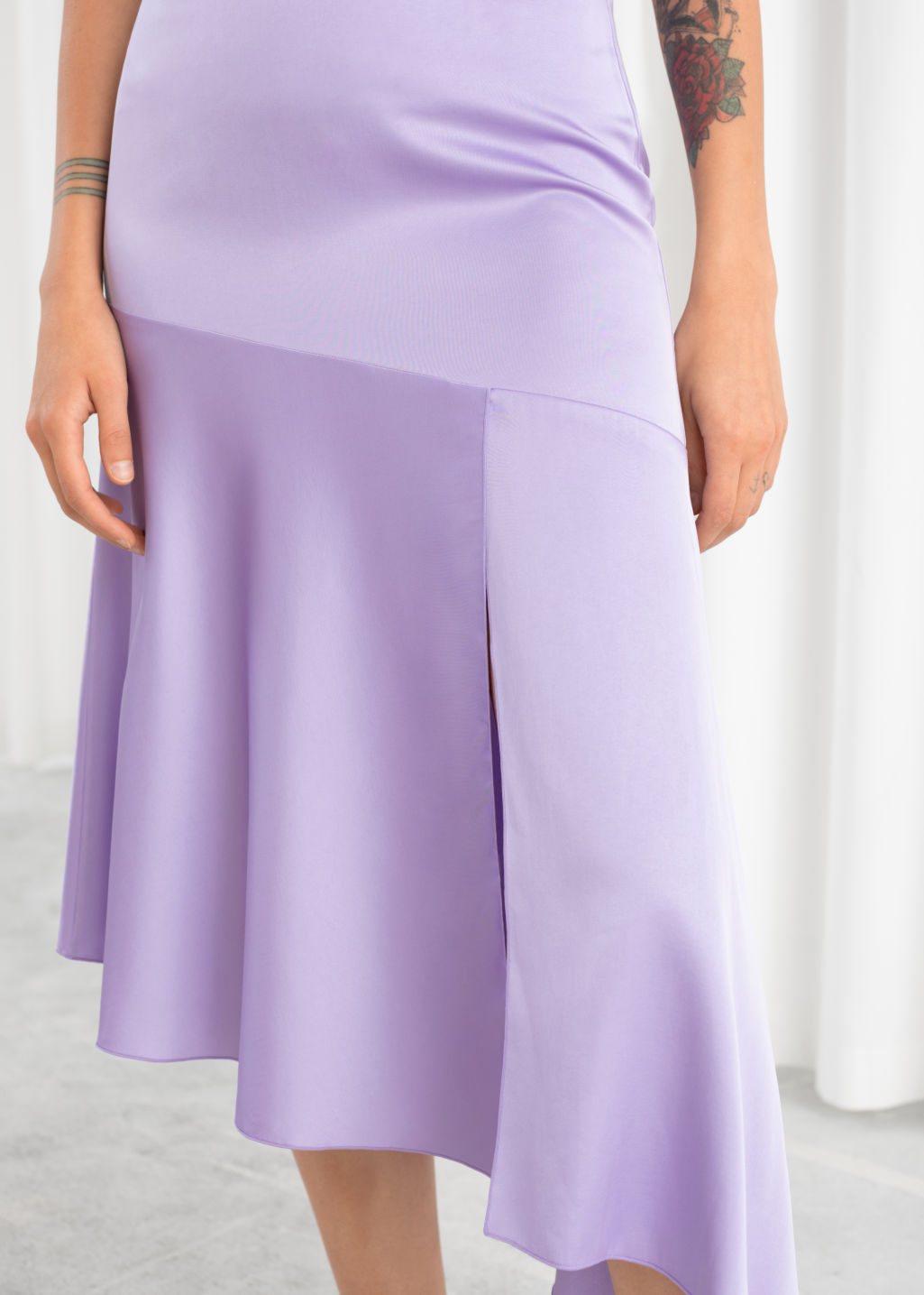 Model back image of Stories asymmetric satin midi skirt in purple