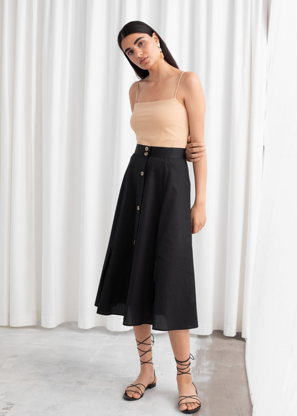 Model front image of Stories striped flared midi skirt in black