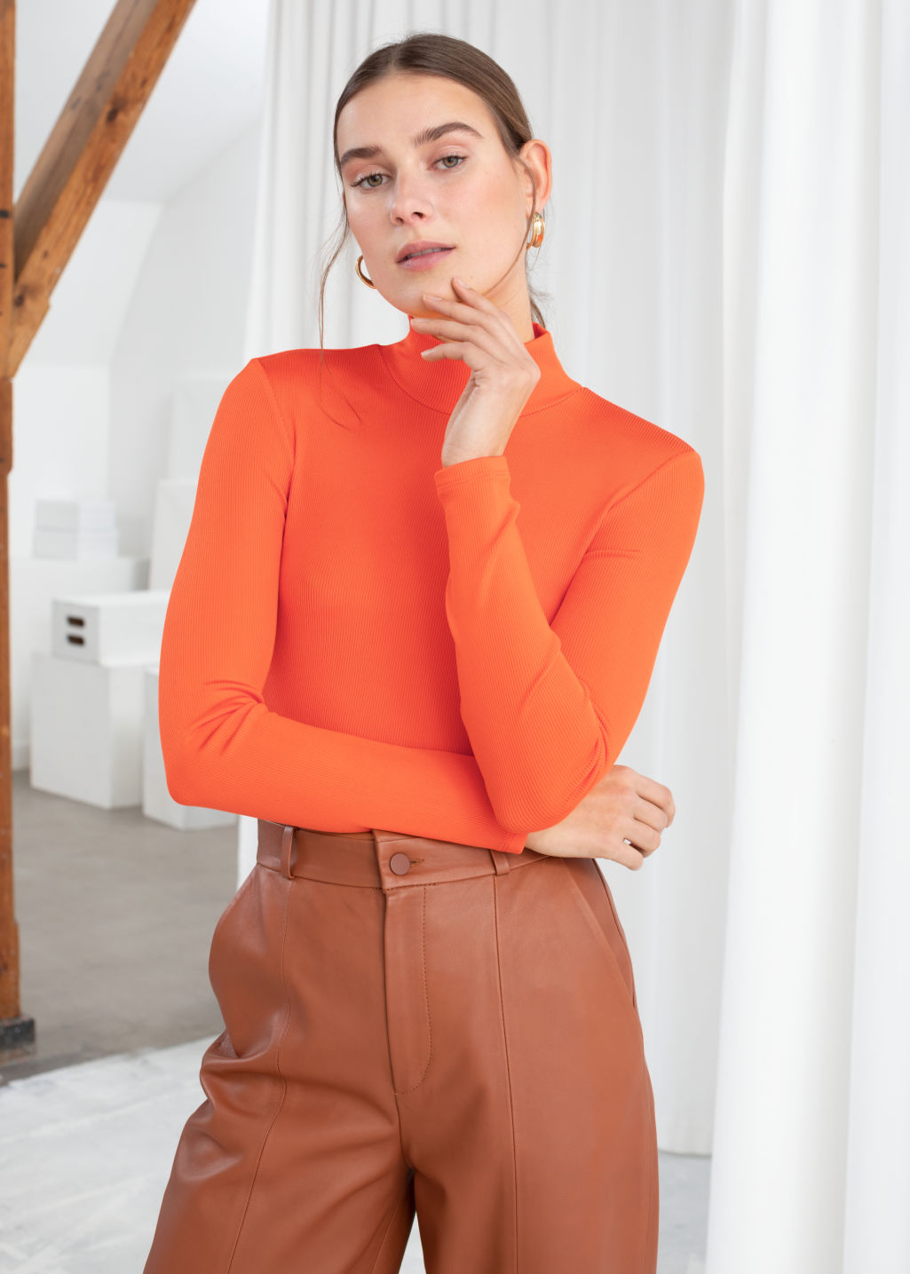 Model front image of Stories fitted long sleeve turtleneck  in orange