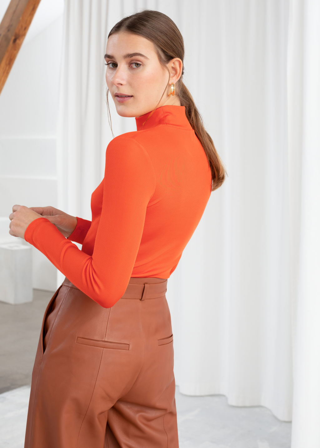 Model back image of Stories fitted long sleeve turtleneck  in orange