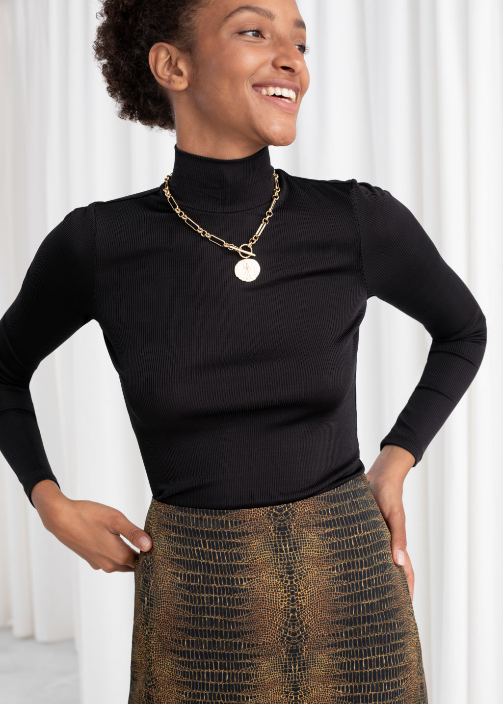 Model front image of Stories fitted long sleeve turtleneck  in black