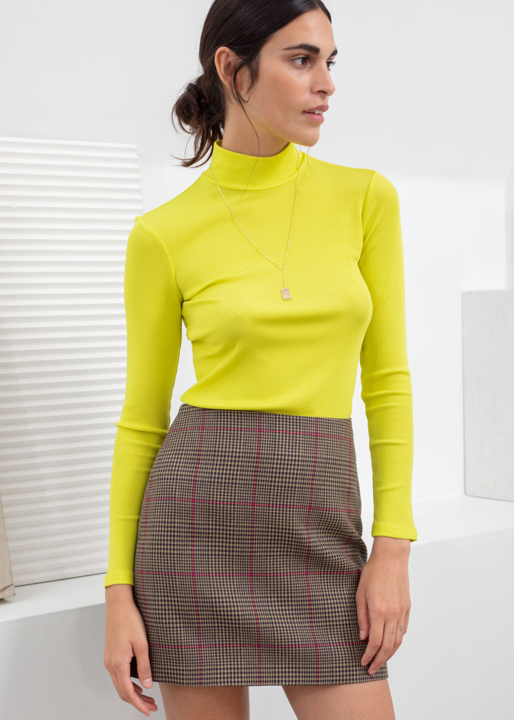 Model front image of Stories fitted long sleeve turtleneck  in yellow