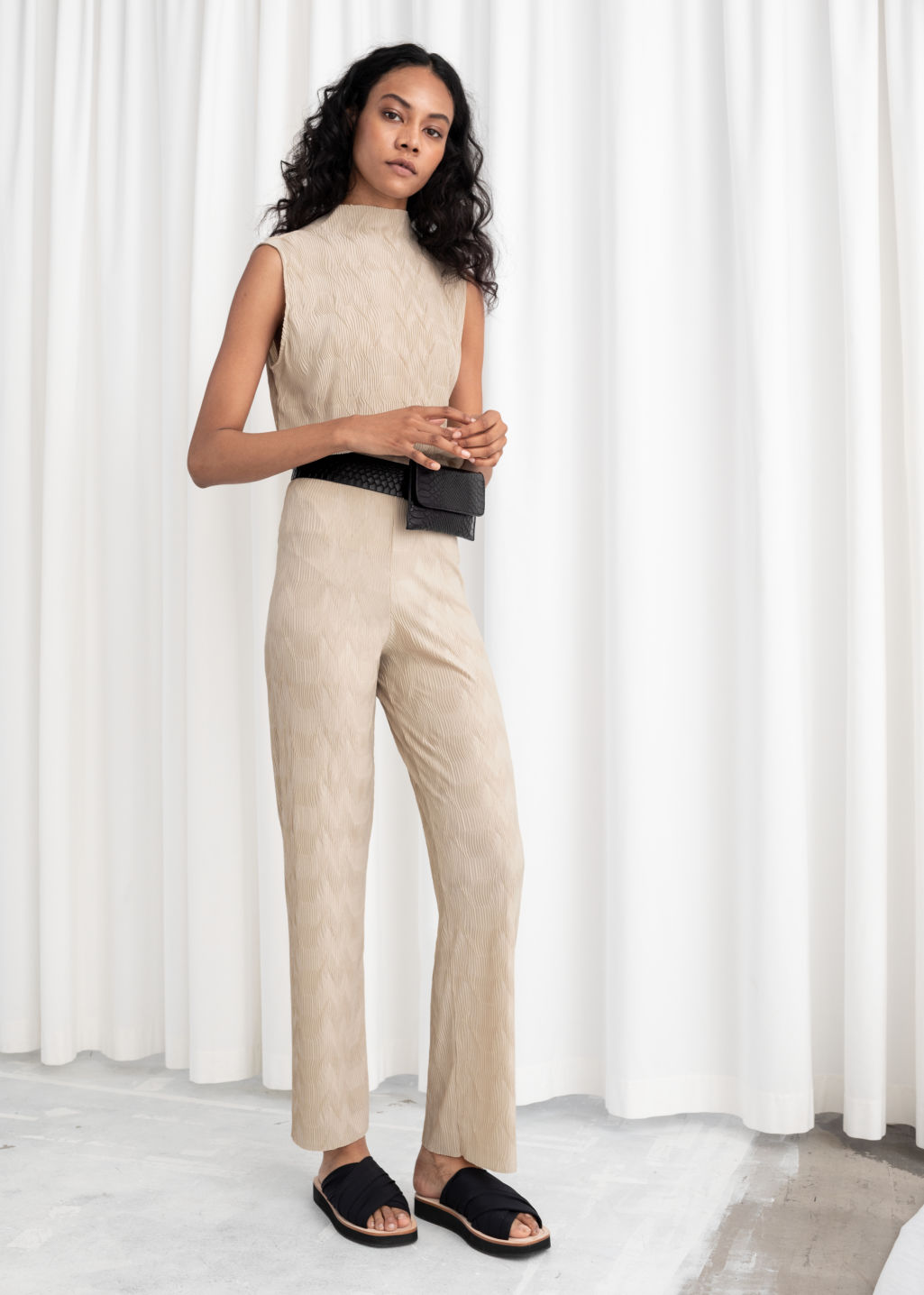 Model front image of Stories plissé pleated fitted trousers in beige
