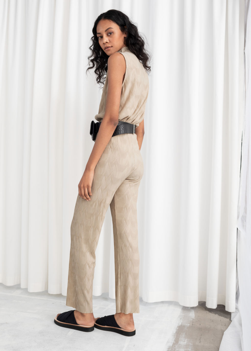 Model back image of Stories plissé pleated fitted trousers in beige