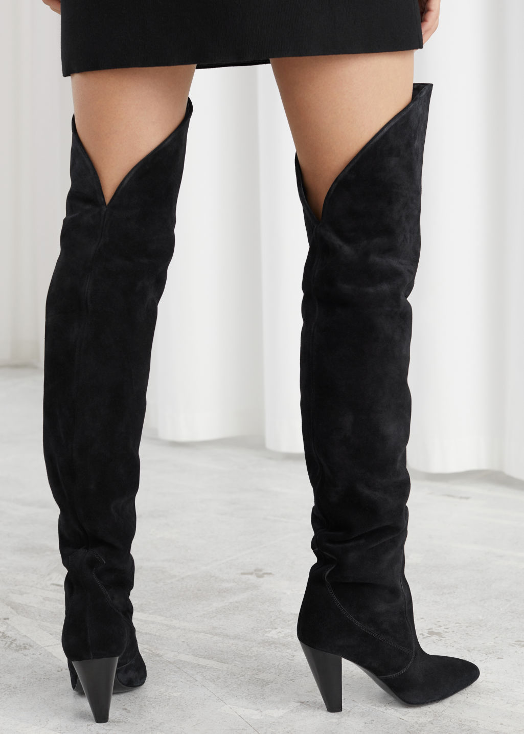 Model back image of Stories suede thigh high cowboy boots in black