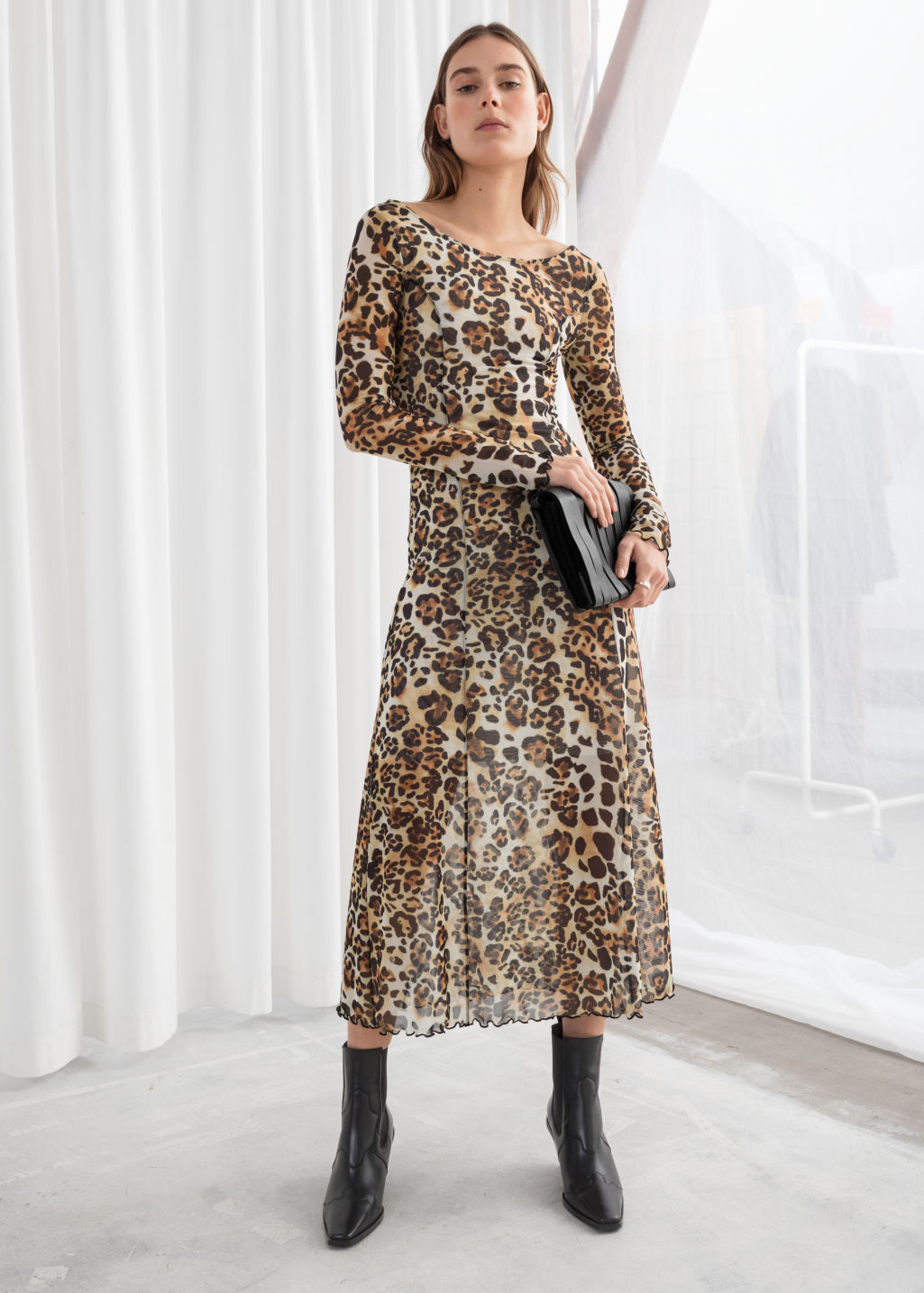 Model front image of Stories mesh cheetah midi dress in white