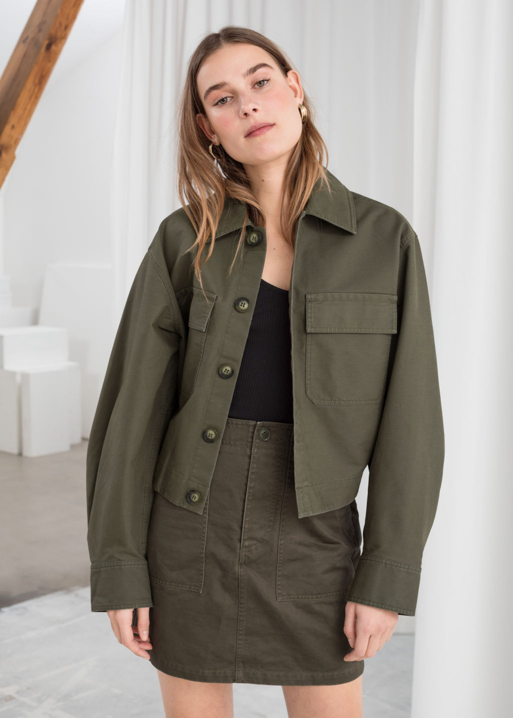 Model front image of Stories cropped cotton twill jacket in green