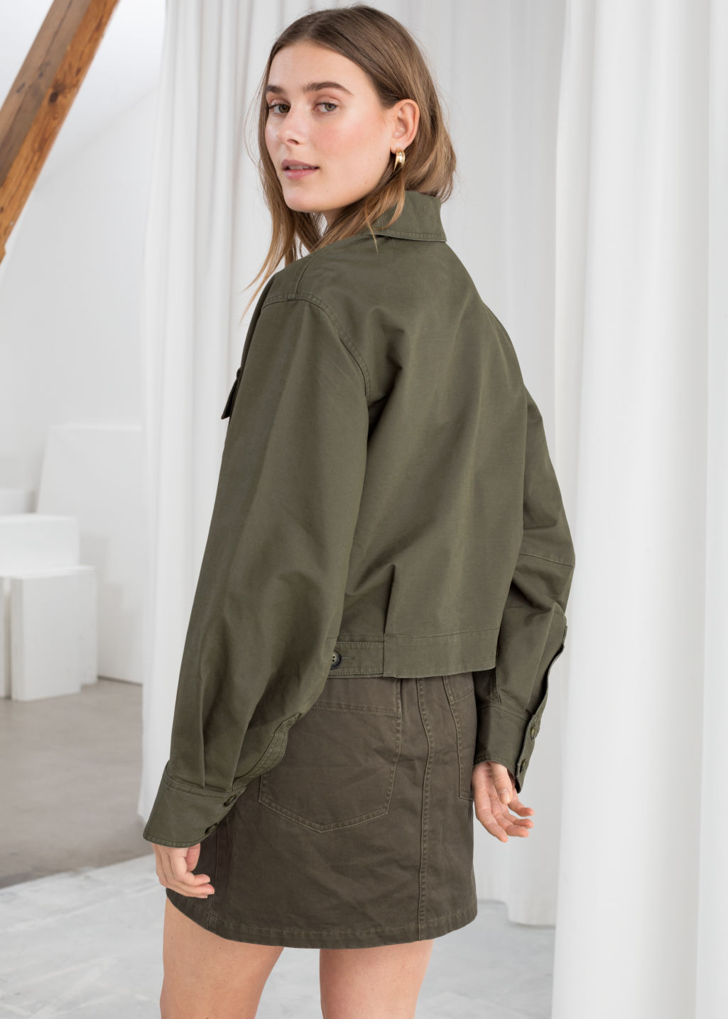 Model back image of Stories cropped cotton twill jacket in green