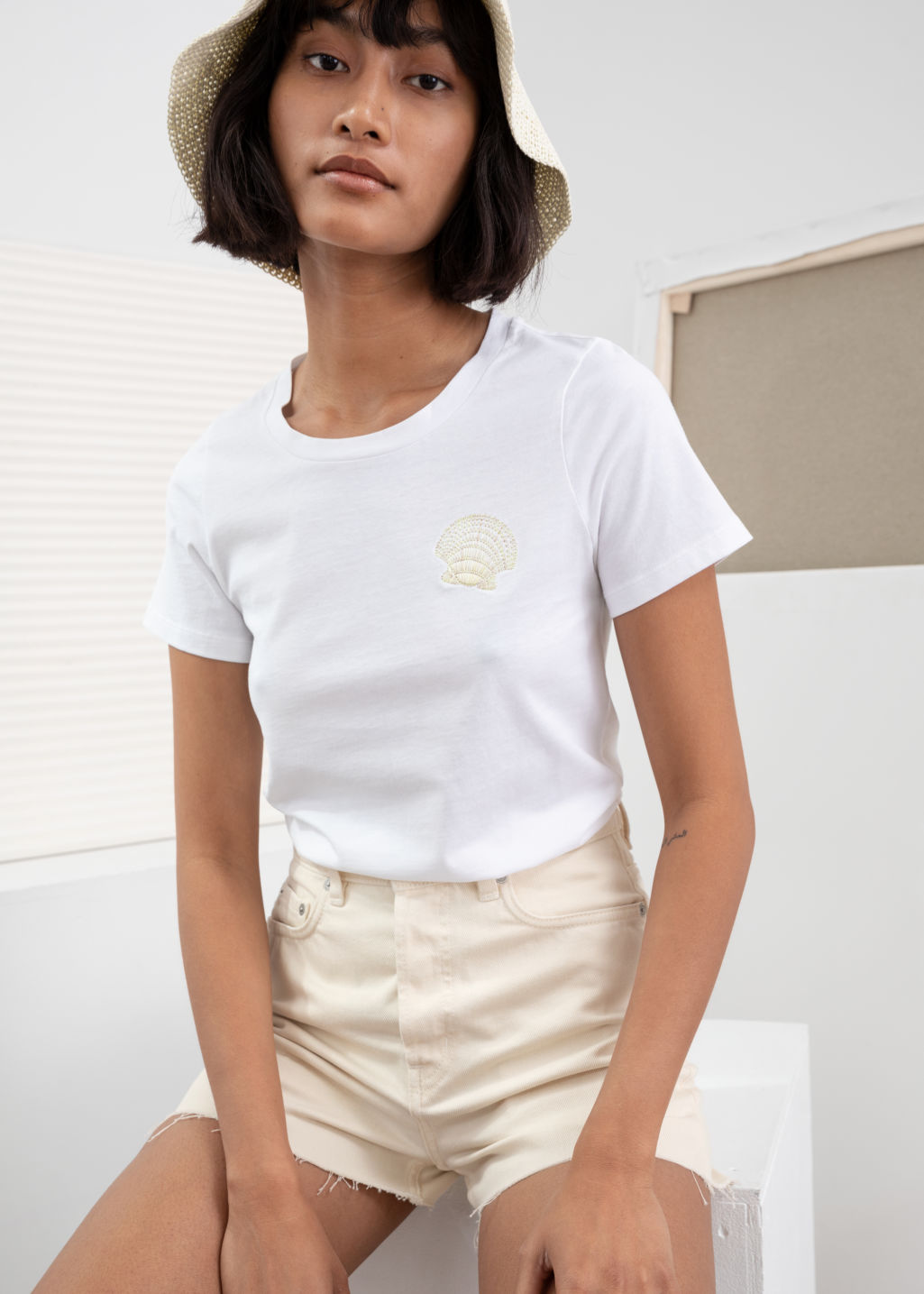 Model front image of Stories seashell embroidered tee in white