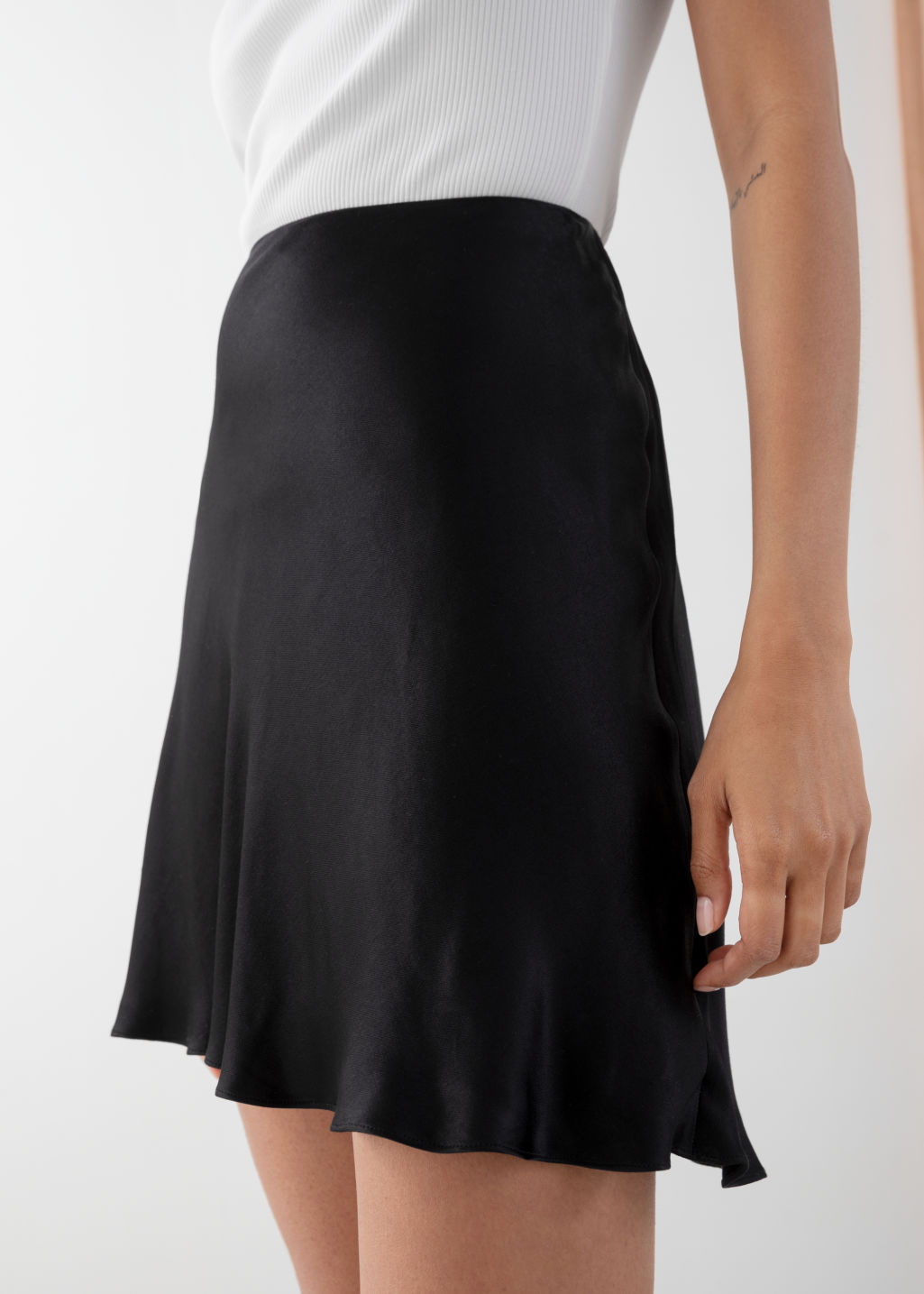Model back image of Stories satin mini skirt in black