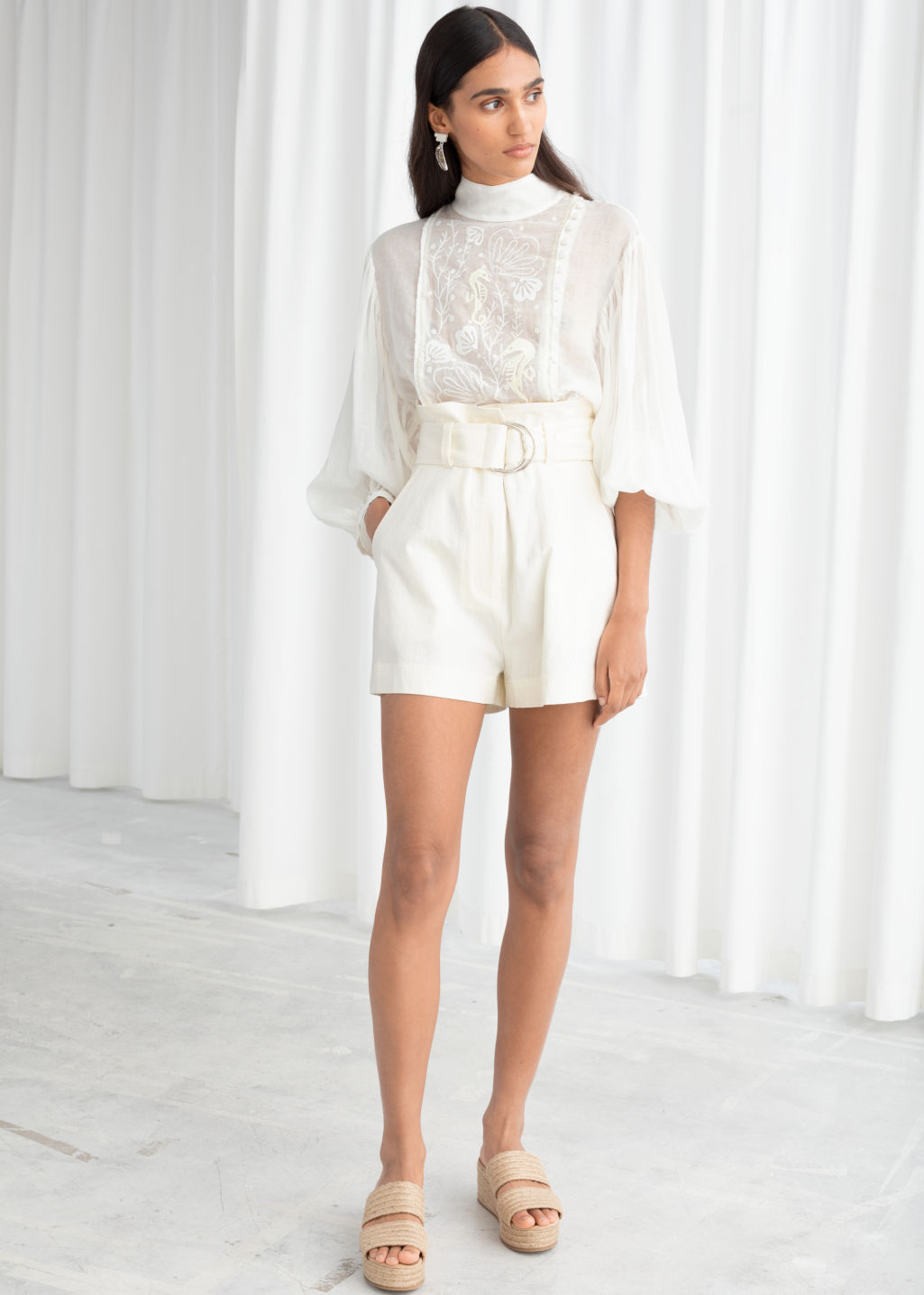Model front image of Stories cotton linen belted shorts in white