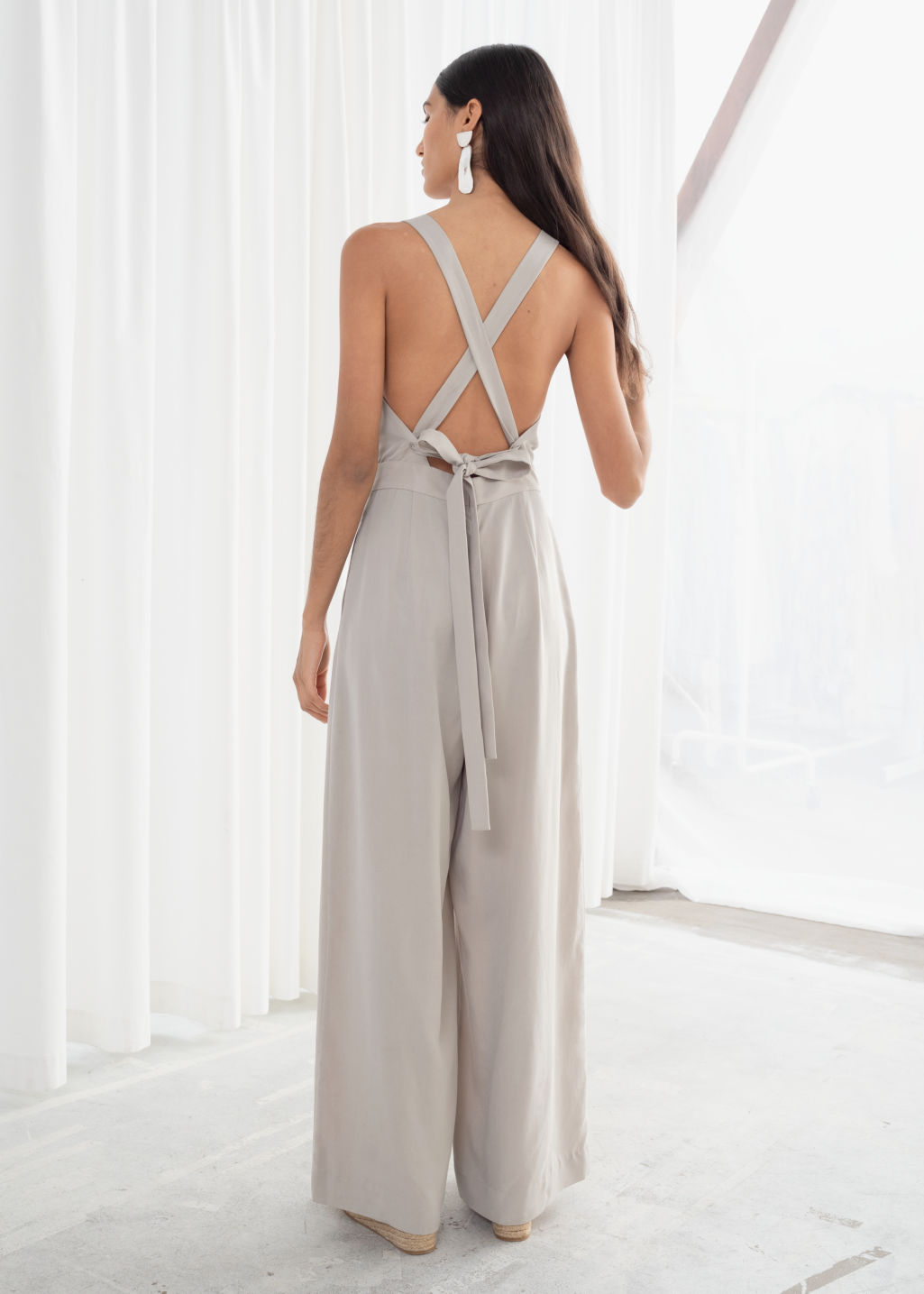 Model back image of Stories lyocell criss cross back jumpsuit  in beige