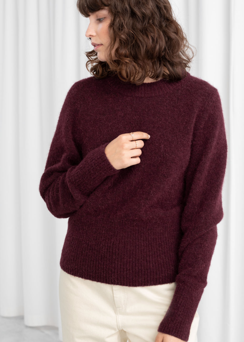 Model front image of Stories alpaca blend fitted puff sweater in red