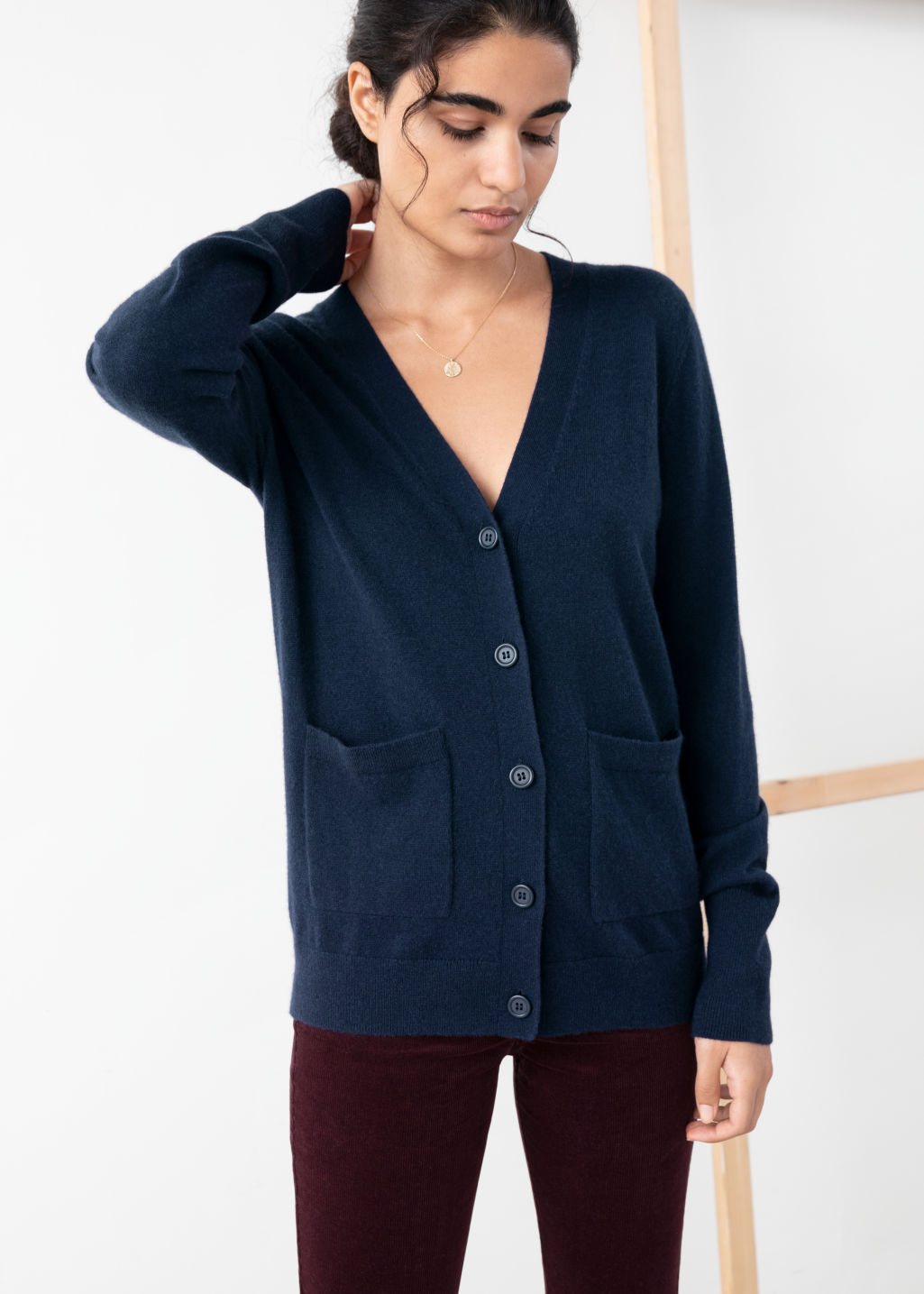Model front image of Stories duo pocket cashmere cardigan  in blue