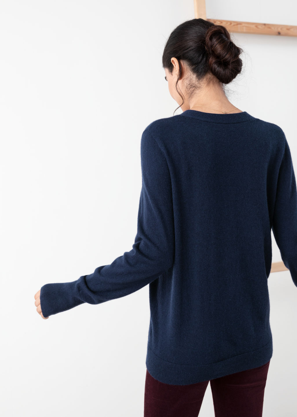 Model back image of Stories duo pocket cashmere cardigan  in blue