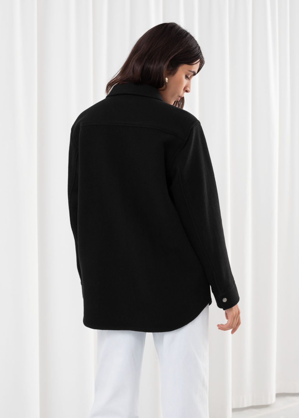 Model back image of Stories oversized wool blend workwear shirt in black