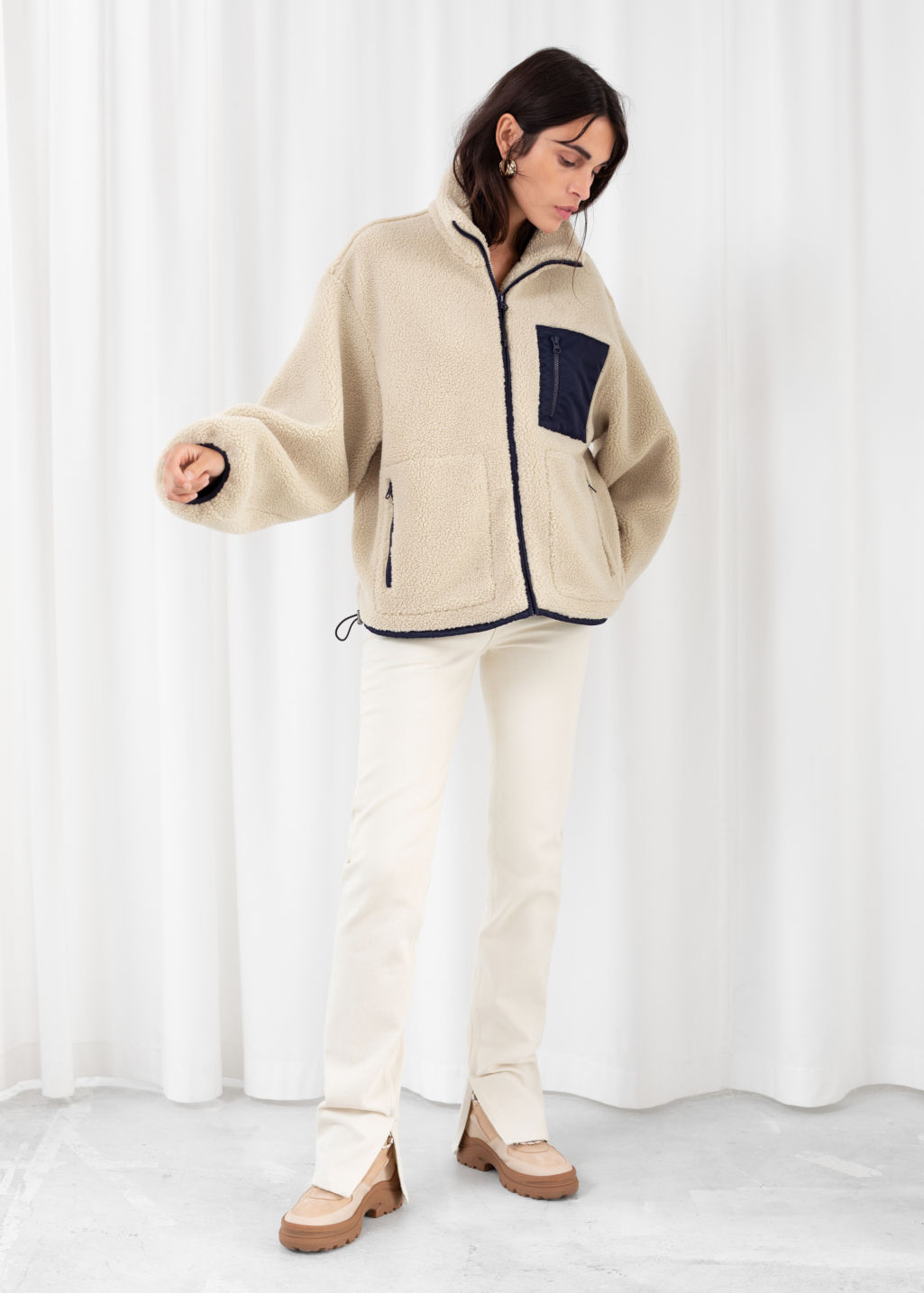Model front image of Stories relaxed utility fleece jacket in beige