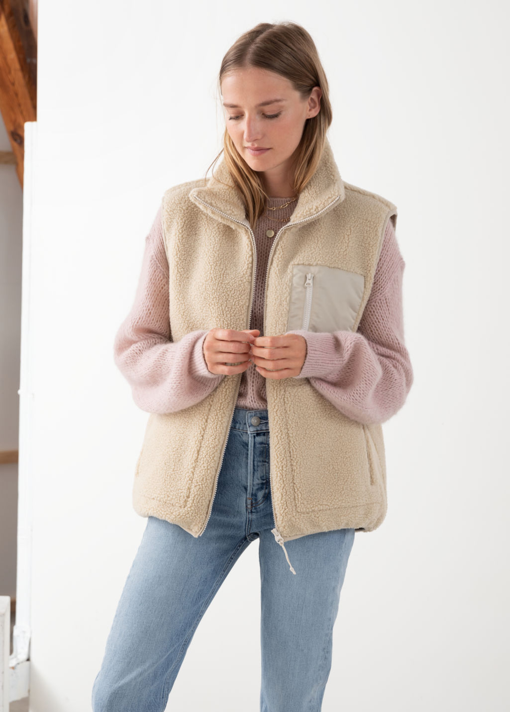 Model front image of Stories faux shearling utility vest in beige