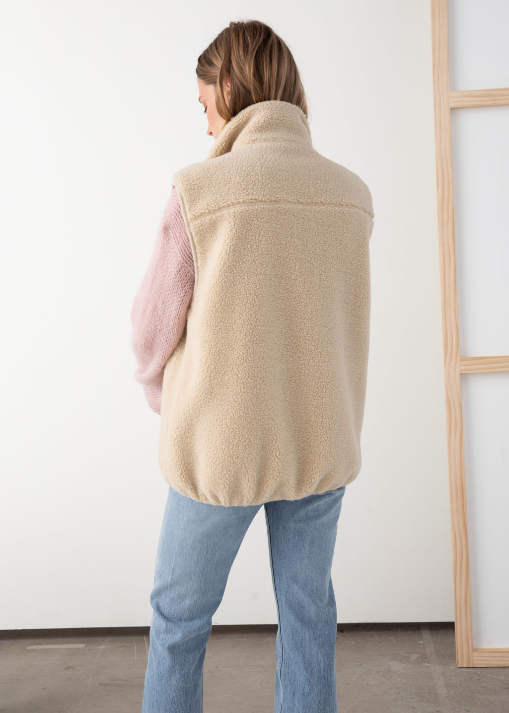 Model back image of Stories faux shearling utility vest in beige