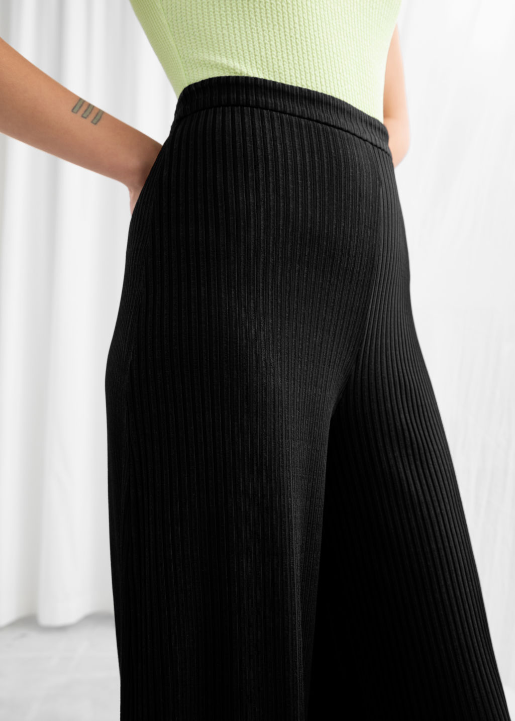 Model back image of Stories stretch rib trousers in black